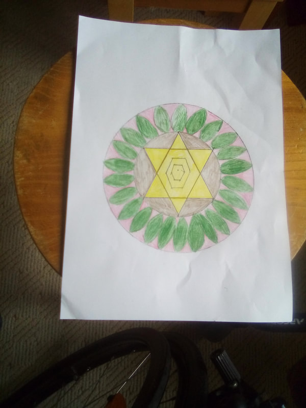 Circle mandala. Yellow six pointed star in a circle of green leaves. By Hannah Sandford.