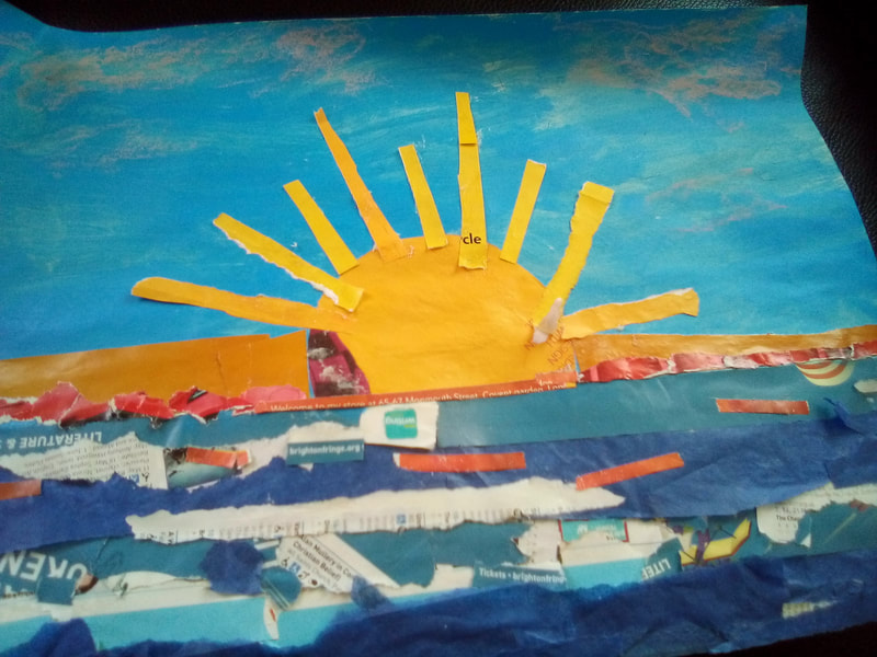 Sunrise over the ocean by Hannah Sandford